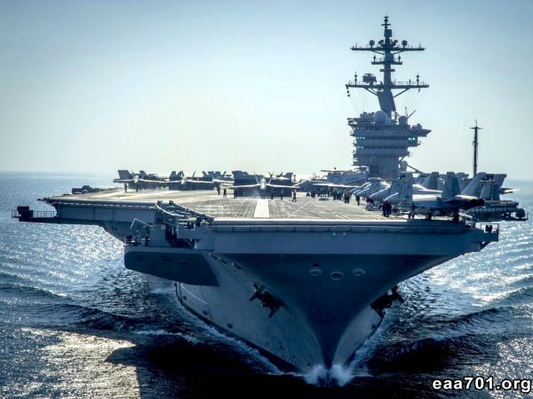 Aircraft carriers in port photo